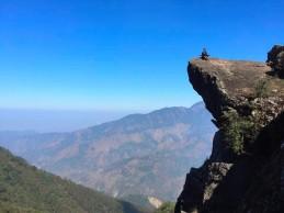 At the edge of a cliff... Mai Meditates